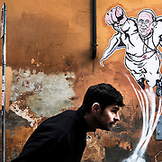 Pope Francis represented as a Super Hero by italian artist  Mauro Pallotta aka MAUPAL, portrayed in the picture,  stands on the wall in a street nearby St. Peter's Basilica and the Vatican.The paper stencil piece of art was created by the Roman Graffiti artist because, he said in an interview to foreing press, we still need Superheros in our world and Pope Francis somehow represents the new Superhero of Faith.