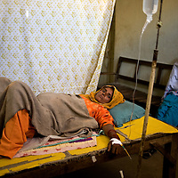 9 months pregnant, this woman came to the local dai of a rural medical centre and waits to go into labour and deliver her first child. In most rural villages the conditions to deliver a baby are very poor and hygiene is just one of the many problems these women face. Kandiaro, Pakistan 2010
