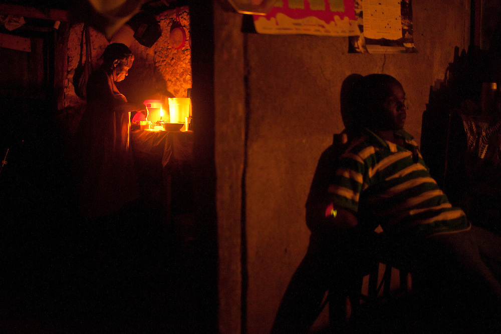 A family sits in their home on July 15, 2010 in Gador, Haiti.