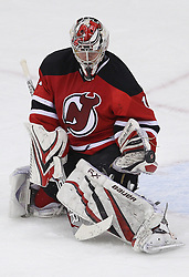 Apr 3; Newark, NJ, USA; New Jersey Devils goalie Johan Hedberg (1) makes a save during the third period at the Prudential Center.  The Devils defeated the Islanders 3-1.