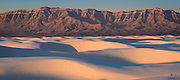 Sand dunes and San Andres Mountains at sunrise; White Sands National Monument, New Mexico.