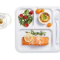 Filet of Alaska Salmon with lemon and dill, mixed green salad with gorgonzola and raspberries, kumquat creme brulee. Photograph by Jonathan Gayman, food styling by Carrie Province.