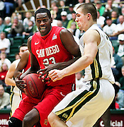 SHOT 1/28/12 4:40:46 PM - San Diego State's DeShawn Stephens #23 drives to the basket in front of Colorado State's Pierce Hornung #4 during their regular season Mountain West conference game at Moby Arena in Fort Collins, Co. Colorado State upset 12th ranked San Diego State 77-60. (Photo by Marc Piscotty / © 2012)