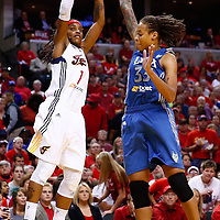 INDIANAPOLIS, IN - OCTOBER 21: Shavonte Zellous #1 of the Indiana Fever shoots the ball against Seimone Augustus #33 of the Minnesota Lynx during Game Four of the 2012 WNBA Finals on October 21, 2012 at Bankers Life Fieldhouse in Indianapolis, Indiana. NOTE TO USER: User expressly acknowledges and agrees that, by downloading and or using this Photograph, user is consenting to the terms and conditions of the Getty Images License Agreement. (Photo by Michael Hickey/Getty Images) *** Local Caption *** Shavonte Zellous; Seimone Augustus