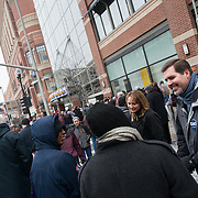 Thayne and Julie McCulloh talk with people during Spokane's Martin Luther King Jr. Day celebrations. (Photo by Rajah Bose)
