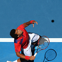 PERTH, AUSTRALIA - JANUARY 03:  Jo-Wilfried Tsonga of France serves to Daniel Munoz-De La Nava of Spain in the men's singles match during day seven of the Hopman Cup at Perth Arena on January 3, 2014 in Perth, Australia.  (Photo by Paul Kane/Getty Images)