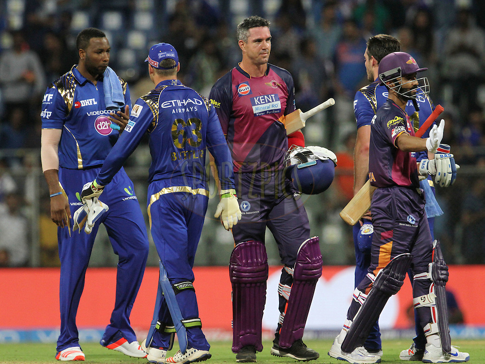 Rising Pune Supergiants player Kevin Pietersen and Rising Pune Supergiants player Ajinkya Rahane shake hands with Mumbai Indians players after the match 1 of the Vivo Indian Premier League ( IPL ) 2016 between the Mumbai Indians and the Rising Pune Supergiants held at the Wankhede Stadium in Mumbai on the 9th April 2016<br /> <br /> Photo by Vipin Pawar/ IPL/ SPORTZPICS