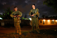 Australian soldiers patrol Dili streets at night.