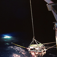 USA, Crew retrieves remote sub onto deck of R/V Thomas G. Thompson in North Pacific Ocean off Washington coast