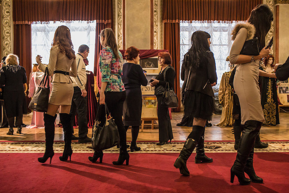 Audience members view an exhibit of costumes at the Donbass Opera on Saturday, March 26, 2016 in Donetsk, Ukraine.