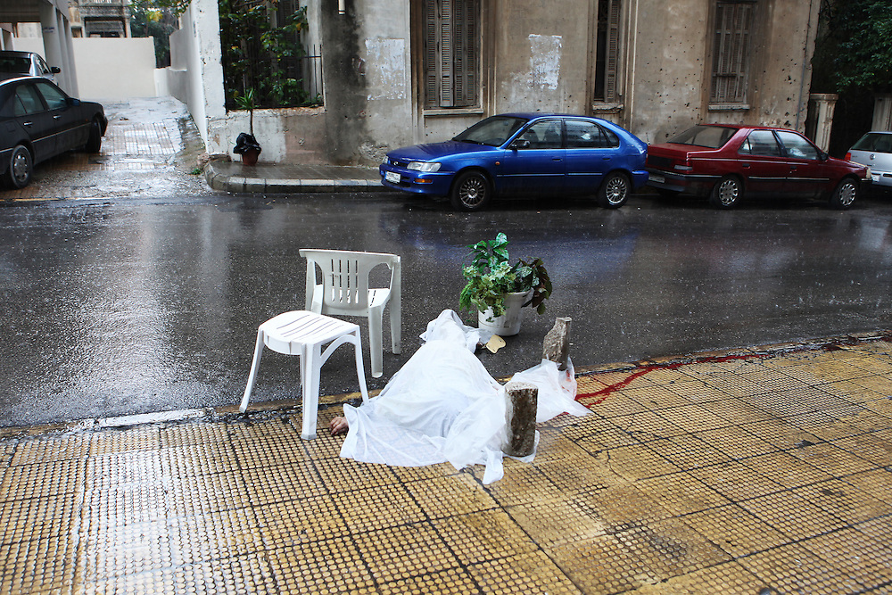 After falling from the seventh floor of her employer's home, the body of 28-year-old Theresa Seda from the Philippines lies in a Beirut street under the rain for hours before medical workers arrived.