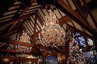 Copper and brass chandeliers in the Chestnut Room. Wood paneling on the ceiling made from antique Chestnut. .(Photo by Robert Caplin)..