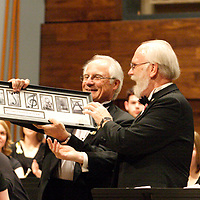 WSU President David Hopkins (left) presents outgoing College of Liberal Arts dean Charles Taylor with a thank you gift at the beginning of the Wind Symphony concert in the brand new Schuster Hall during the 13th Annual ArtsGala at Wright State University's Creative Arts Center, Saturday, March 31, 2012.  Hopkins remarked as he was getting ready for the presentation, 'after 37 years of magnificent service to this great university, there's a gentleman in this house, and you've already met him, who thinks we're gonna let him retire.'
