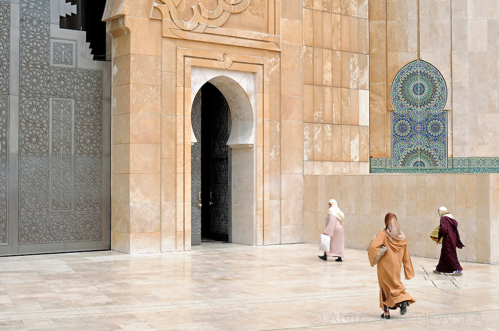 Morocco, Casablanca. Women are going to the Hassan II Mosque.