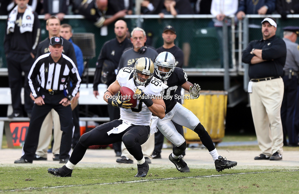 New Orleans Saints tight end Jimmy Graham (80) catches a fourth quarter pass during the NFL week 11 football game against the Oakland Raiders on Sunday, Nov. 18, 2012 in Oakland, Calif. The Saints won the game 38-17. ©Paul Anthony Spinelli