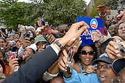 ATLANTA, GA - April 14, 2007: Senator Barack Obama reaches into an adoring crowd of supporters after delivering a speech at Georgia Tech.