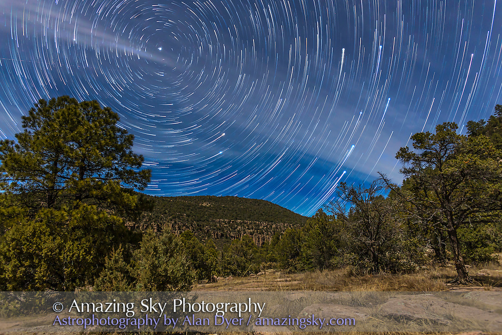 Circumpolar star trails on a moonlit night in the Gila National Forest in southern New Mexico, north of Pinos Altos. Polaris is at upper left, the Little Dipper hanging below it, and the stars of the Big Dipper are rising at right, with the end star of the handle still to clear the horizon. Illumination is from the waxing quarter Moon. The night had a lot of high cloud drifting through, adding the streaks and patchiness to the sky. <br />
