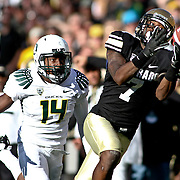 SHOT 10/22/11 4:17:52 PM - Colorado's Toney Clemons #7 can't quite come up with a reception in front of Oregon's Ifo Ekpre-Olomu #14 along the sidelines during their regular season PAC-12 game at Folsom Field in Boulder, Co. Oregon won the game 45-2. (Photo by Marc Piscotty /  © 2011)