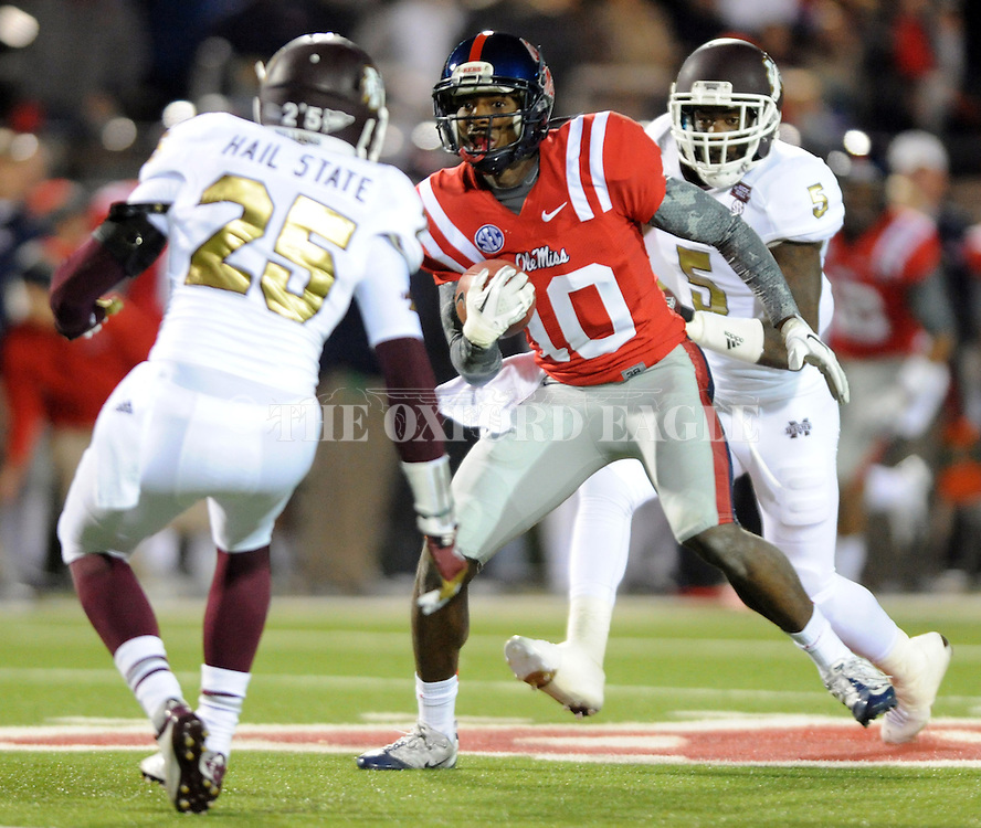 Mississippi wide receiver Vince Sanders (10) makes a catch between Mississippi State defensive back Corey Broomfield (25) and Mississippi State defensive back Nickoe Whitley (5) at Vaught Hemingway Stadium in Oxford, Miss. on Saturday, November 24, 2012. (AP Photo/Oxford Eagle, Bruce Newman).