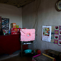 NORTHERN HEBEI PROVINCE, JANUARY 26, 2009:<br /> A TV set stands in a corner of my Lu's parents' home. Watching TV is possible only when there's a signal which doesn;'t happen too often.<br />   <br /> Lu went to Beijing 8 years ago as he couldn't find a job in China's countryside.<br /> He was employed in a textile factory that went banctrupt last October. Lu and his 63 colleagues were still owed payment for 4 months, but their boss refused to pay them. They didn't know the law, nor did any of them have a contract.  <br /> At the end of January, Lu and his co-workers went to see the bosses' mother to negociate, then the union and in the end the government. They were threatened with jail . At the end of the day , a man from the union came by ( on behalf of the government )and all but an underaged worker received their due salaries.<br /> Now Lu is unemployed like 20 milion other migrant workers in China who have been laid off as a result of the financial crisis.<br /> <br /> <br /> China's Communist Party  which will celebrate its 60th anniversary in October, currently faces its biggest challenge since the beginning of the economic reforms 30 years ago  : &quot; The phase of  rapid economic growth is over. For the first time the government is threatened with a  mistrust of a wide section of the population&quot;, warns the Communist party's Shang Dewen in Beijing.   <br /> Not only the China's poorest worry about the furture, but as well China's middle class is concerned about the crisis.     1,5 Millionen university graduates didn't find a job until the end of 2008  and this summer there'll be an additional  6,1 Million new graduates. More than 12 percent of university graduates face unemployment in 2009.