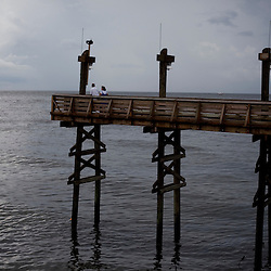 From left, Richard and Anne Perkins of New Orleans look on into the Gulf on June 23, 2010 in Grand Isle State Park, LA where oil has reached the shore. The couple came to Grand Isle to see what effect the oil was having on the Gulf.