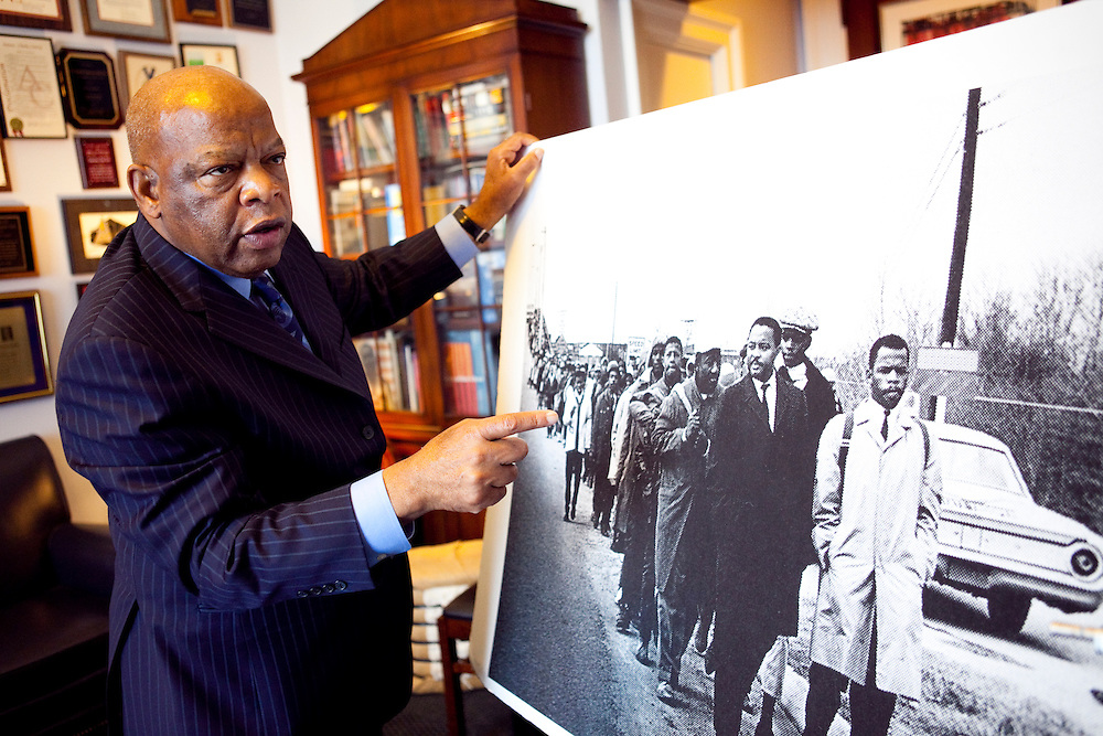 Rep. John Lewis (D-GA) shows off a photo of himself marching during the civil rights era after an interview in his office on Capitol Hill on Tuesday, Apr. 21, 2009 in Washington, DC.