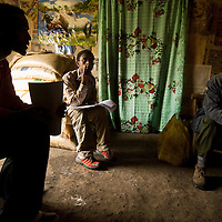 Taking a health survey, nursing students in Sendafa, Ethiopia interview a resident in his home, where he lives without benefit of running water or electricity.