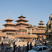 """Patan's Durbar Square, in Nepal, Asia. Patan was probably founded by King Veer Deva in 299 AD from a much older settlement. Patan, officially called Lalitpur, the oldest city in the Kathmandu Valley, is separated from Kathmandu and Bhaktapur by rivers. Patan (population 190,000 in 2006) is the fourth largest city of Nepal, after Kathmandu, Biratnagar and Pokhara. The Newar people, the earliest known natives of the Kathmandu Valley, call Patan by the name """"Yala""""  (from King Yalamber) in their Nepal Bhasa language. UNESCO honored Patan's Durbar Square (Palace Square) as one of the seven monument zones of Kathmandu Valley on their World Heritage List in 1979. All sites are protected under Nepal's Monuments Preservation Act of 1956. Panorama stitched from 2 photos."""