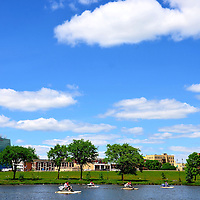 St. Cloud Skyline from Lake George with Paddleboats in St. Cloud, Minnesota<br /> There are 95 parks for the 65,000 people who live in St. Cloud, Minnesota.  One of them is Eastman Park.  Located near downtown, it offers regular community events or just a relaxing paddleboat ride around Lake George.  On the right is the Cathedral of Saint Mary, a Catholic church built in 1920.