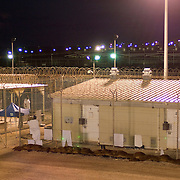 "Detainees seen outside their cells in Camp 4 at the detention facility in Guantanamo Bay, Cuba. Camp 4 is a communal style camp where more compliant detainees live in small groups and have access to a more open air environment. Approximately 250 ""unlawful enemy combatants"" captured since the September 11, attacks on the United States continue to be held at the detention facility.(Image reviewed by military official prior to transmission)"