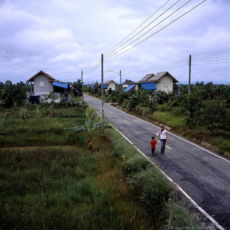 """Rotan Batu, also known informaly as """"Widdows village"""" started functioning in 2004 as a project that was funded and created by Thailand's Queen Sirikit, who donated 20m baht ($514,000) of her own money to purchase the land on which the village is now located. Its purpose is to give shelter and work to mainly Muslim widows who lost their husbands during the insurgency in the south of Thailand. They now live there about 450 people, the widows together with other members of their families. The village is self sufficient as there is enough farm-land where they produce the vegetables and fruit for themselves and sell the extra production in local markets. They also create handcrafts which are sold as souvenirs in other parts of Thailand giving them some extra income. The village is considered quite safe but it is guarded by solders 24 h a day to make sure no attack happens there."""