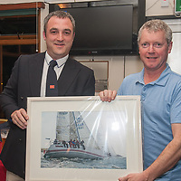 Mark Ivers Bad Company winner Class 2 IRC receives his prize from Kieran O' Connell Commodore Scora