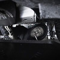 01/07/11 Wilmington DE: Glacier Autos Mechanic Brandon prepares to drains coolant from the radiator of a 2006 Pontic Grand Prix into a large container at Glacier Autos in Wilmington Delaware Friday afternoon. <br /> <br /> Special to Monsterphoto/SAQUAN STIMPSON