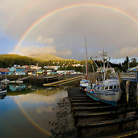 A rainbow reflects into the Cordova,Alaska harbor near the end of the salmon fishing season in the fall. Cordova is home to the Copper River commercial salmon fishing fleet on the north gulf coast of Alaska.