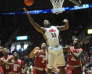 "Mississippi's Murphy Holloway (31) grabs a rebound against Arkansas' Rickey Scott (3) and Arkansas' Marshawn Powell  (33) at the C.M. ""Tad"" Smith Coliseum on Saturday, January 19, 2013. (AP Photo/Oxford Eagle, Bruce Newman)"