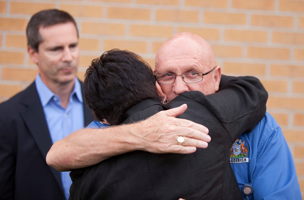 Goderich mayor  Delbert Shewfelt hugs  Huron Bruce MPP Carol Mitchell following a press conference in Goderich Ontario, Monday, August 22, 2011 after the community which was hit by a Tornado Sunday afternoon.<br /> THE CANADIAN PRESS/ Geoff Robins