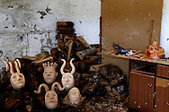 """Wooden masks pictured at a craftsman house during the traditional Celtic carnival """"Caretos"""" in the village of Lazarim, central Portugal on February 17, 2015. PAULO CUNHA /4SEE"""