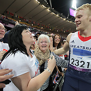 LONDON 2012 PARALYMPIC GAMES.. Pic shows Johnnie Peacock being mobbed by his family including his mum Linda Roberts (black hair white t shirt)after winning the 100m at the Paralympics on Sept 6th 2012... Britain's Jonnie Peacock has sealed his status as the fastest amputee in the world after winning the 100m T44 race in a new Paralympic record...Peacock, 19, stormed away from the field and finished in 10.90 seconds, ahead of US sprinter Richard Browne, who was second in 11.03secs and South Africa's Arnu Fourie, who ran 11.08secs for bronze...Defending champion, South Africa's 'Blade Runner' Oscar Pistorius, who was runner-up in the 200m, was never in contention this time around, finishing fourth...