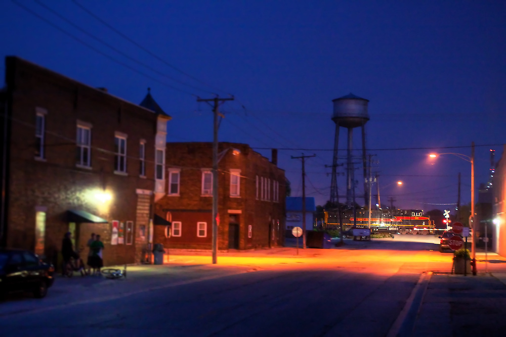 IAIS 509 West, the BICB-10 rolls through downtown Rockdale, IL at 9pm as a few local kids gather at the convenience store for a snack.