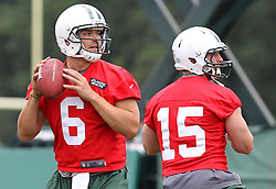 June 14, 2012; Florham Park, NJ, USA; New York Jets quarterback Mark Sanchez (6) and New York Jets quarterback Tim Tebow (15) throw passes during New York Jets Minicamp at the Atlantic Health Training Center.