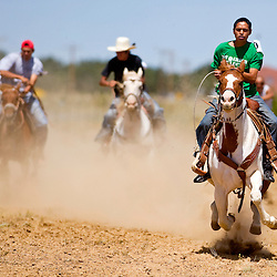 082809   Brian Leddy.Izzy Gonnie races his horse across the finish line during a heat on Friday at the annual Ramah Navajo Fair. The fair continues through this weekend with rodeos, fireworks, dancing and a variety of other activities.