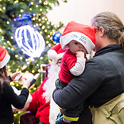Gonzaga students and families got their pictures taken with Santa and Spike on Dec. 4 in the Hemmingson Center. (Photo by Edward Bell)