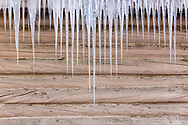 Icicles hanging from roof on building in Southcentral Alaska. Winter. Morning.