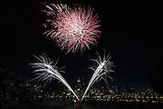 Fourth of July fireworks over Portland light up the sky.