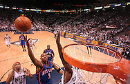 Anfernee Hardaway (center) of the NY Knicks driving to the basket between Kenyon Martin (left) and Rodney Rodgers (right) of the NJ Nets in the first half of their Game #1 playoff game at the Continental Airlines Arena in East Rutherford, NJ on Saturday, April 17, 2004. The Nets defeated the Knicks 107-83.