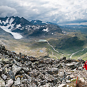 """In Jotunheimen National Park, Styggedalsbreen glacier flows from Store Styggedalstind (2387 meters or 7831 feet, in the Hurrungane Range), the fourth highest summit in Norway. For impressive views of """"the Home of the Giants,"""" walk 15 kilometers round trip through Helgedalen valley, with 1170 meters gain from Turtagrø Mountain Hotel to Fannaråken mountain (or Fannaråki, 2068-meters / 6785 feet elevation) in Luster municipality, Sogn og Fjordane county, Norway. Panorama stitched from 7 overlapping photos."""
