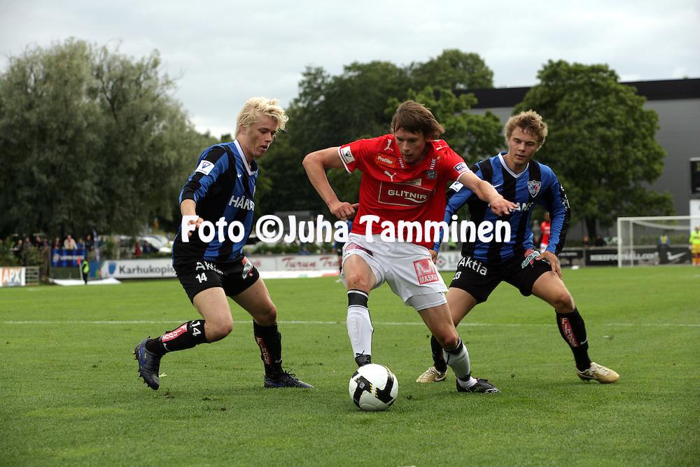 04.08.2008, Veritas stadion, Turku, Finland..Veikkausliiga 2008 - Finnish League 2008.FC Inter Turku - FC TPS Turku.Kasper H?m?l?inen (TPS) v Joni Aho & Ville Nikkari (Inter).©Juha Tamminen.....ARK:k