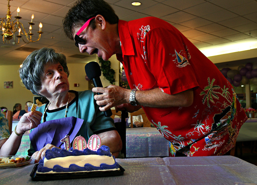 Jonathan Miano / Staff photographer 20070627 Naperville.Bessie Dvorak celebrates her 100th birthday with entertainer Brian Fowler at the Meadowbrook Manor in Naperville Wednesday.