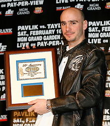 December 11, 2007; New York, NY, USA;  Unbeaten World Middleweight Champion Kelly Pavlik poses with his award for being named the WBO's Fighter of the Year at the press conference announcing his rematch against former champion Jermain Taylor, which will take place Saturday, February 16, 2008, at MGM Grand in Las Vegas, NV.  Taylor missed attending the press conference due to the birth of his baby girl on Monday evening.