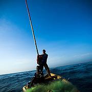 Fishermen head back to shore near Cape Coast, roughly 120km west of Ghana's capital Accra on Thursday April 9, 2009..